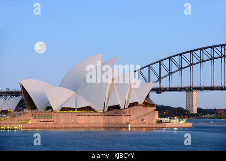 Image of the full super Moon shining right before sunrise over the Sydney Opera House in Sydney, Australia as it - Stock Photo