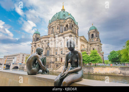 Berlin cathedral, view of the Berliner Dom cathedral with detail of the statue group titled Three Girls And A Boy - Stock Photo