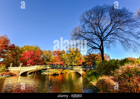 The Bow Bridge is a cast iron bridge located in Central Park, New York City, crossing over The Lake and used as - Stock Photo