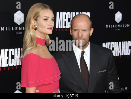 HOLLYWOOD, CA - AUGUST 22:  Rosie Huntington-Whiteley, Jason Statham  arrives at the Premiere Of Summit Entertainment's - Stock Photo