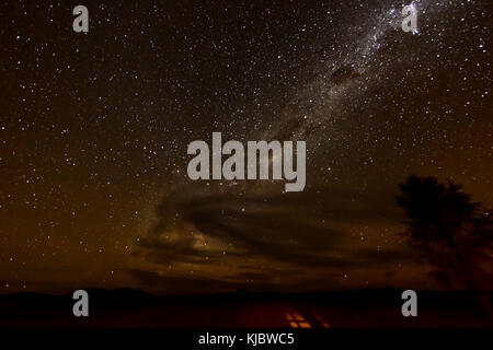 View of the starry sky and the Milk Way from NamibRand Nature Reserve, Namibia. - Stock Photo
