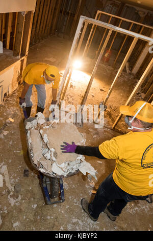 Humble, Texas - Oklahoma volunteers from the Southern Baptist Convention clean debris from the Mana Family Worship - Stock Photo