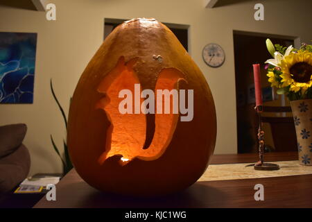 A squirrel carved into a pumpkin on Halloween. - Stock Photo