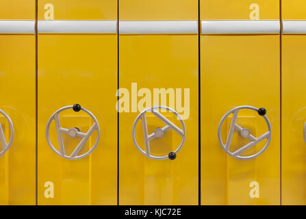Front view of  files cabinet  in yellow color. White labels and copy space - Stock Photo