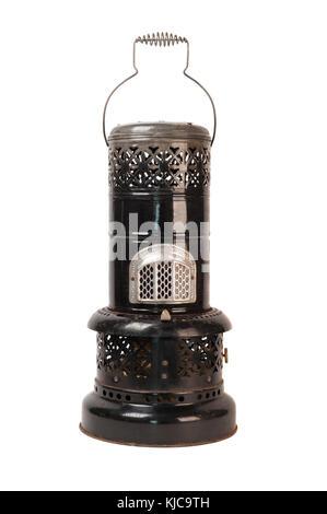 Old black kerosene heater isolated on white - Stock Photo