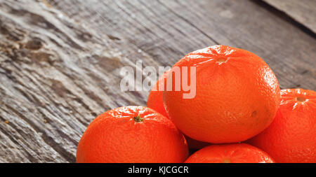 Tangerines on a wooden table, copy space - Stock Photo