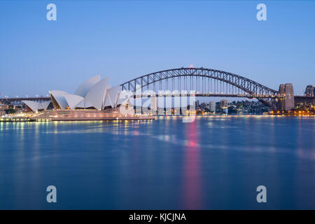 Sydney Opera House and Harbour Bridge in Sydney, New South Wales (NSW), Australia as it was seen from Mrs Macquarie's - Stock Photo