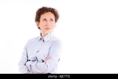 Beautiful mature business woman isolated over white background. Smiling curly hair business woman with folded hands - Stock Photo