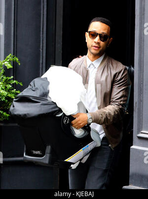 NEW YORK, NY - MAY 17: John Legend and new daughter Luna as they leave their apartment on May 17, 2006 in New York - Stock Photo
