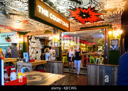 The Courtyard at nighttime, a trendy bar and restaurant in central Cairns, Far North Queensland, FNQ, QLD, Australia - Stock Photo
