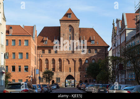 Szeroka Street and Crane (Zuraw) Gate at the Main Town (Old Town) in Gdansk, Poland, on a sunny day. - Stock Photo