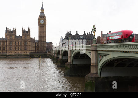 View over the River Thames of Westminster Bridge with Big Ben, London red double decker bus, Portcullis House, and - Stock Photo