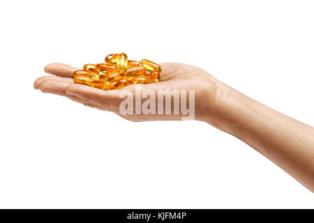 Many capsules Omega 3 in man's hand isolated on white background. Close up. High resolution product. Health care - Stock Photo