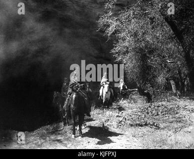 Photograph of a group of Native American men riding horses in the desert, titled 'Out of the Darkness, Navajo Indians - Stock Photo