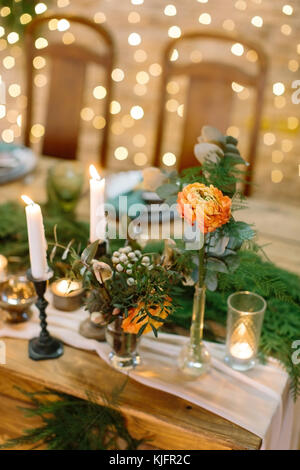 wedding decor, romance, love concept. on the blured background with numerous of twinkle lights there are posies - Stock Photo