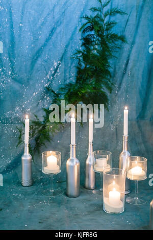 nature, winter, studio design concept. on the background of textile blue drapping covered with dots of white paint - Stock Photo