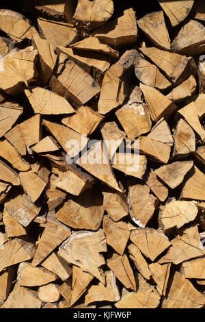 stack of firewood prepared for winter - Stock Photo