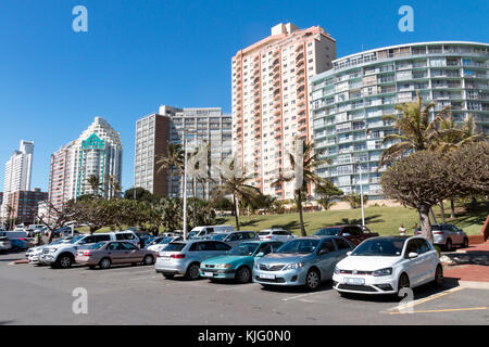 DURBAN, SOUTH AFRICA - NOVEMBER 17, 2017 : Empty early morning  parked vehicles and comercial and residential buildings - Stock Photo