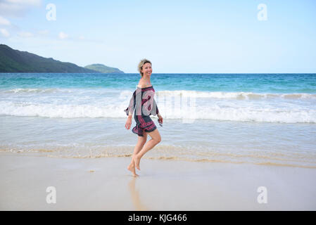 Dominican Republic, Samana, happy woman walking on the beach - Stock Photo