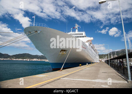 Large passenger cruise liner Thomson Spirit docked at Marmaris port in Turkey and viewed from the jetty alongside - Stock Photo