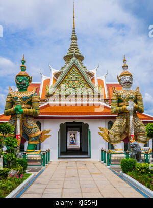 Entrance doorway to ordination hall with Yaksha guardians in the Wat Arun Temple, Bangkok, Thailand - Stock Photo