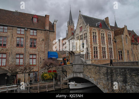 Bruges, Belgium - March 12, 2016: View of the Basilica of the Holy Blood and statue of St Joannes Nepomucenus on - Stock Photo