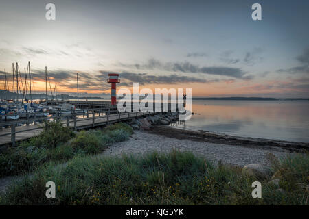 Germany, Eckernfoerde, view to Baltic sea with new light house at morning twilight - Stock Photo