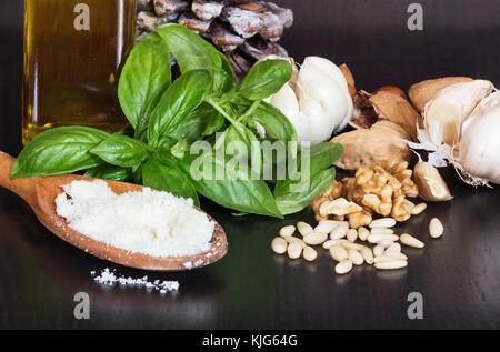 ingredients fresh green pesto sauce homemade on wooden table background, Basil pesto sauce and fresh ingredient - Stock Photo