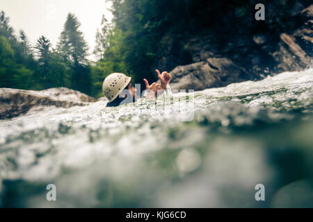 Germany, Bavaria, Allgaeu, man canyoning in Ostertal - Stock Photo