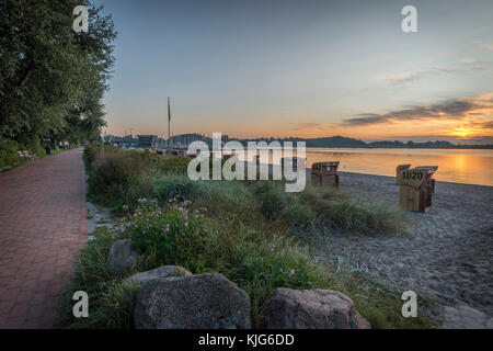 Germany, Eckernfoerde, view to Baltic sea and beach at sunrise - Stock Photo