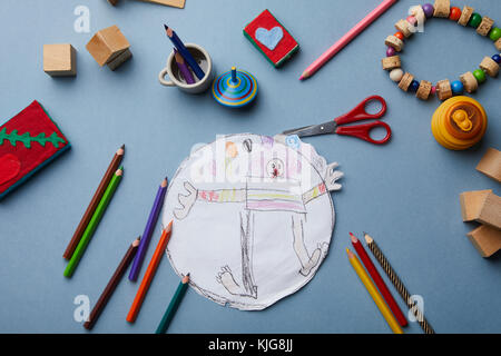 Child's drawing, coloured pencils and accessories - Stock Photo