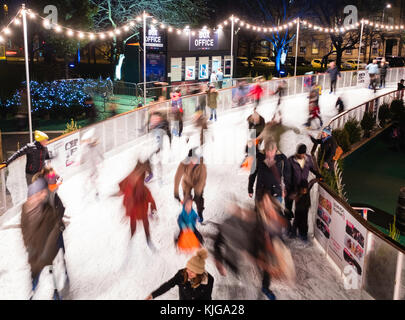Ice skaters on ice rink in St Andrews Square in Edinburgh during the Christmas Festivities in the city in 2017. - Stock Photo