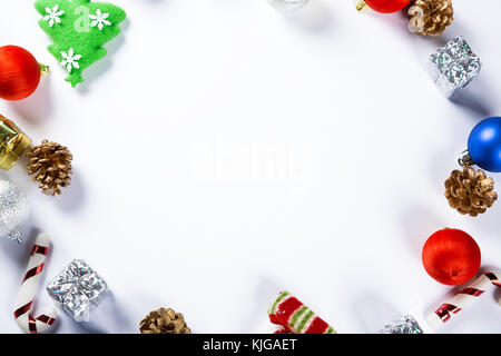Christmas round frame with gifts, toys, decorations on white background. Simple Christmas composition with free space