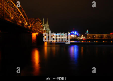 View on Hohenzollern Bridge, Musical Dome and Cologne Cathedral in at night - Stock Photo
