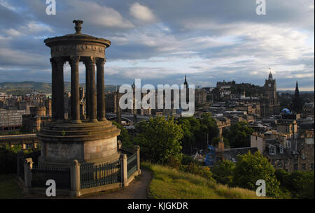 View of Edinburgh at sunset from Carlton Hill - Dugald Stewart Monument - Stock Photo