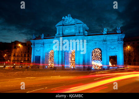 Puerta de Alcala illuminated in blue, night view. Madrid, Spain. - Stock Photo