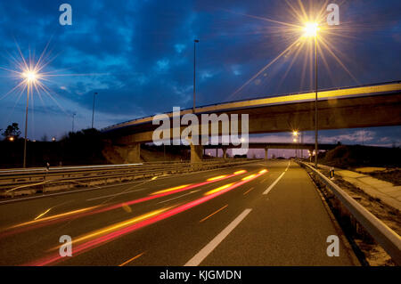 R-3 toll motorway at dusk. Madrid, Spain. - Stock Photo