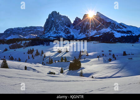 Winter sunrise over Alpe di Siusi with view on Sassolungo and Sassopiatto, Dolomites, Italy - Stock Photo