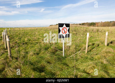 Protective sign warning against digging at an archaeological site on Salisbury Plain, Wiltshire, England, UK - Stock Photo
