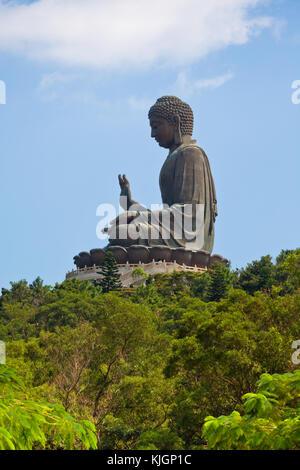 Tian tan giant buddha from Po Lin monastery Lantau island in Hong Kong - Stock Photo