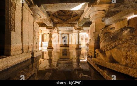Flooded underground Shiva temple with water reflection in Hampi, Karnataka, India. - Stock Photo
