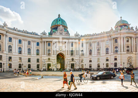 VIENNA, AUSTRIA - AUGUST 28: Tourists at the famous imperial Hofburg palace in Vienna, Austria on August 28, 2017. - Stock Photo