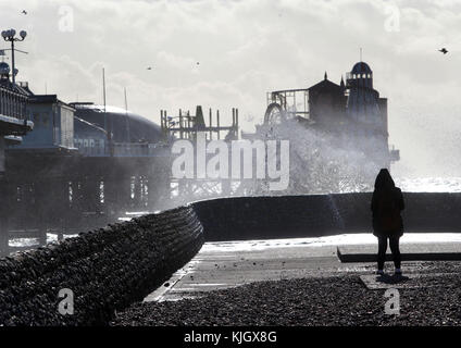 Brighton, UK. 23rd November, 2017. High winds and seas whip up a sea spray in Brighton as Britain braces for a bout - Stock Photo