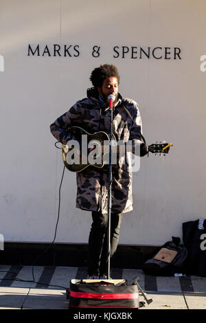 Dundee, Tayside, Scotland, UK. 23rd November, 2017. Local street entertainer from band BLACK BLOOD wrapped up warm - Stock Photo