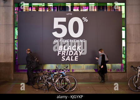 Oxford Street, London, UK. 23rd Nov, 2017. Black Friday sale signs on Oxford Street shops. Credit: Matthew Chattle/Alamy - Stock Photo