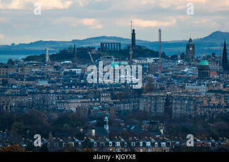 Edinburgh, Scotland, United Kingdom, 23rd November 2017. View over Edinburgh skyline in low Autumn sunlight with - Stock Photo