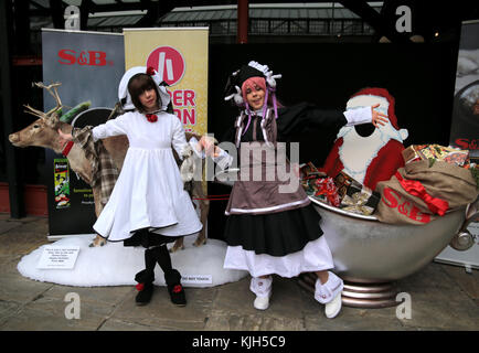 London, UK. 24th November, 2017. Hyper Japan Christmas 2017 open its doors in Tobacco Docks ,to all things Japanese ,from cultural performances ,the always sought after Manga magazines ,traditional food,the world famous Japanese drink Saki and a host of calligraphy ,pop ,cosplay ,mascots ,and Ukiya,pictures of the floating world so characteristic Japanese@Paul Quezada-Neiman/Alamy Live News Stock Photo