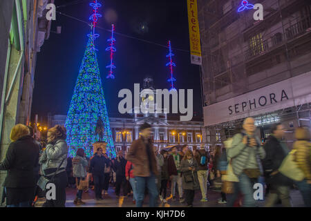 Madrid, Spain. 24th November, 2017. People gather to watch a traditional massive Christmas tree lighting at Sol - Stock Photo