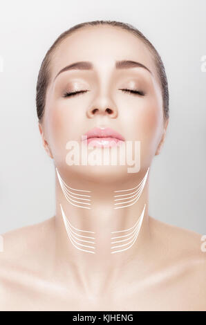 woman with arrows on her neck. lifting concept. - Stock Photo