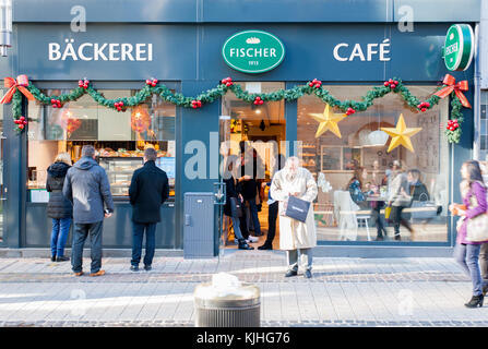 Queue in front of the Fischer Backerie. One of the biggest patisserie in Luxembourg. People buying sandwich for - Stock Photo